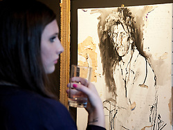 © Licensed to London News Pictures. 24/02/2012. LONDON, UK. An art fan views a portrait by 'Wolf Man' a friend of Pete Doherty and decorated with the singers blood, at an exhibition in Camden today (24/02/12). The exhibition entitled 'On Blood: A Portrait of an Artist', held at the Cob Gallery in Camden and set to run between the 26th of February and the 4th of March, features works and collections by the former Libertines lead singer. Photo credit: Matt Cetti-Roberts/LNP