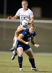 Virginia Cavaliers M/F Sinead Farrelly (17) leaps over Liberty Flames M/D Tanya Payne (19).  The Virginia Cavaliers faced the Liberty Flames at Klockner Stadium in Charlottesville, VA on September 21, 2007