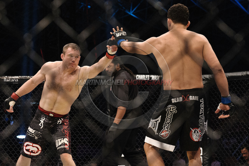 """ABU DHABI, UNITED ARAB EMIRATES, APRIL 10, 2010: Matt Hughes (left) and Renzo Gracie (right) touch gloves at the start of the first round of their fight at """"UFC 112: Invincible"""" inside Ferari World, Abu Dhabi on April 10, 2010"""