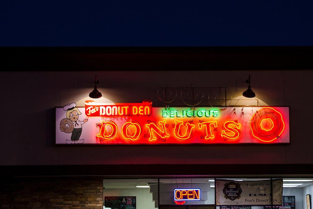 Neon illuminated Donut Den sign