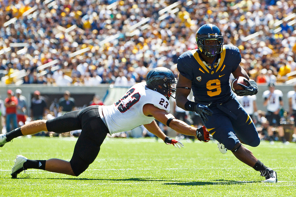 BERKELEY, CA - SEPTEMBER 08: Running back C.J. Anderson #9 of the California Golden Bears breaks a tackle from defensive back Brennan Fjord #23 of the Southern Utah Thunderbirds to score a touchdown during the first quarter at Memorial Coliseum on September 8, 2012 in Berkeley, California. (Photo by Jason O. Watson/Getty Images) *** Local Caption *** C.J. Anderson; Brennan Fjord