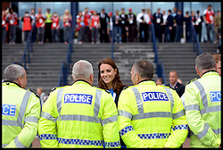 Image licensed to i-Images Picture Agency. 29/07/2014. Glasgow, United Kingdom. The Duke and Duchess of Cambridge and Prince Harry talk to police officers at the Athletics, Hampden Park, Glasgow on day six of the Commonwealth Games.  Picture by Andrew Parsons / i-Images