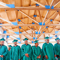 062813       Cable Hoover<br /> <br /> Class of 2013 graduates stand together during the New Life Learning Center graduation ceremony at the Fort Defiance chapter house Friday.