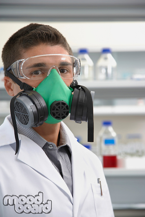 Scientist wearing a gas mask in laboratory