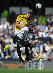 Brentford James Tarkowski holds of Derby Darren Bent, Derby County v Brentford, Sy Bet Championship, IPro Stadium, Saturday 11th April 2015. Score 1-1,  (Bent 92) (Pritchard 28)<br /> Att 30,050