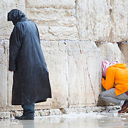 Two men pray at as snow and rain fall at The Western Wall on January 7, 2015 in Jerusalem, Israel. (Photo by Elan Kawesch)