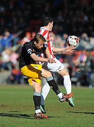Mansfield Town's Ricky Ravenhill loses possession to Cheltenham Town's Matt Sparrow  - Photo mandatory by-line: Nizaam Jones  - Mobile: 07966 386802 - 07/03/2015 - SPORT - Football - Cheltenham - Whaddon Road- Cheltenham Town v Mansfield - Sky Bet League Two