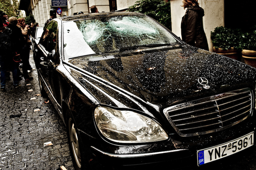 A luxurius car damaged by protesters during general strike and protest march against austerity cuts organised by workers unions, Athens, Greece 15 December 2010.