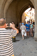 family taken a picture at a tourist site France La Cite Carcassonne