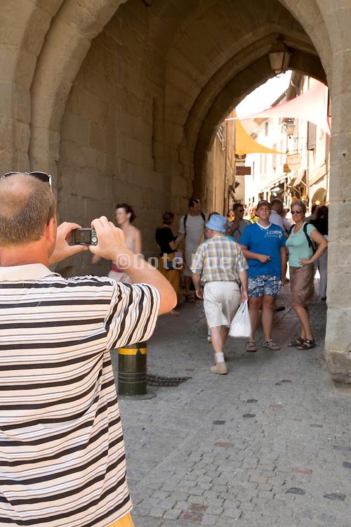 family taken a picture at a tourist site France La Cite Carcassonne