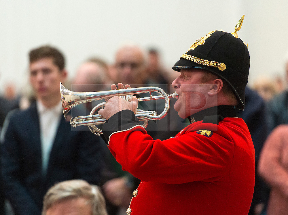 © Licensed to London News Pictures. 08/11/2015. Duxford, UK. A trumpeter playing The Last Post at an official service of Remembrance and wreath laying ceremony at Imperial War Museum Duxford, Cambridgeshire on Remembrance Sunday 2015. . Photo credit: Ben Cawthra/LNP