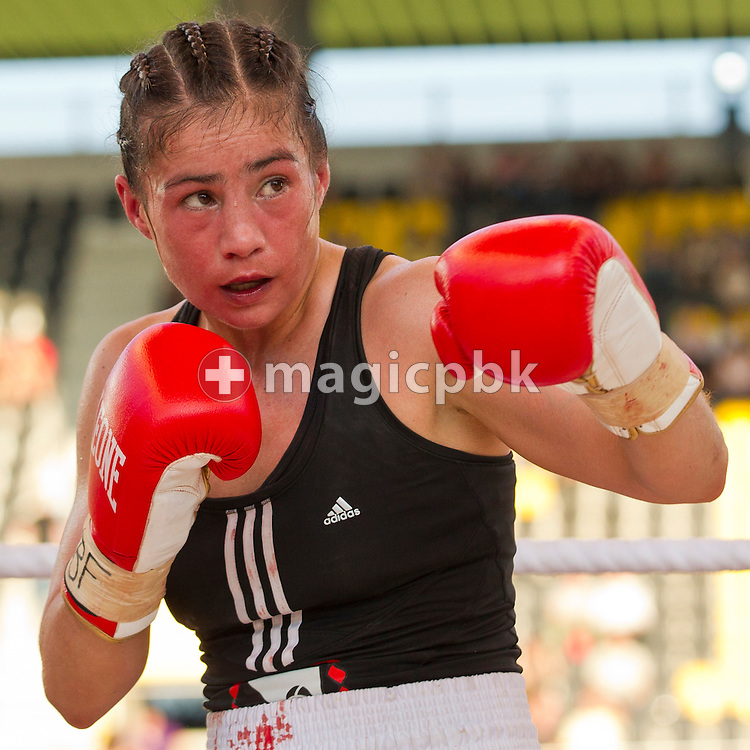 Aniya Seki of Switzerland fights against Eva Marcu of Hungary during their Super Flyweight title fight at the Stade de Suisse Wankdorf in Bern, Switzerland, Saturday, July 7, 2012. (Photo by Patrick B. Kraemer / MAGICPBK)