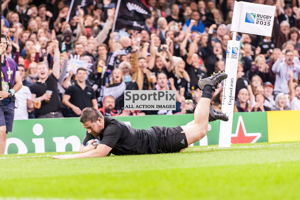 All Black Dane Coles dives over for a try. Action from the New Zealand v Georgia game in Pool C of the 2015 Rugby World Cup at Milennium Stadium in Cardiff, 2 October 2015. (c) Paul J Roberts / Sportpix.org.uk