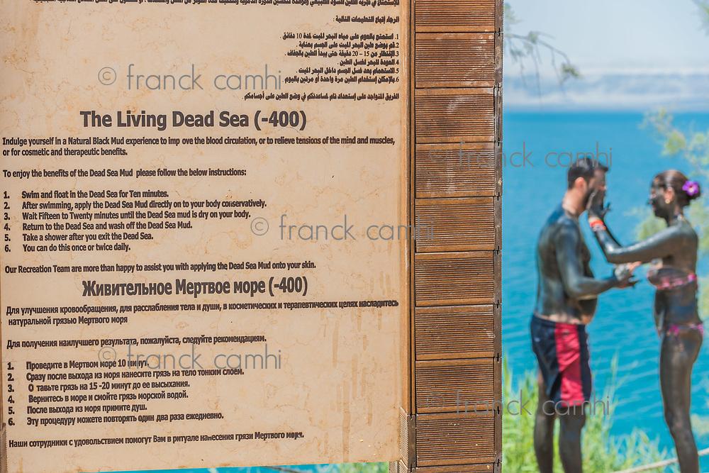 Dead Sea, Jordan - May 6, 2013 people applying Dead Sea mud body care treatment on May 6 2013 , in Dead Sea Jordan