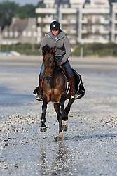 Wild Thing L with his groom on the beach<br /> Winner of the Derby Laiterie de Montage - Region Pays de La Loire<br /> Longines Jumping International de La Baule 2015<br /> © Hippo Foto - Dirk Caremans<br /> 16/05/15