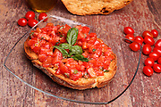 Traditional Italian Recipes - Apulian bread rings (friselle) with fresh chopped tomatoes, basil and olive oil.