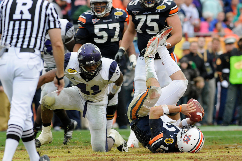 January 1, 2010: Linebacker Quentin Davie of the Northwestern Wildcats sacks quarterback Chris Todd of the Auburn Wildcats during the NCAA football game between the Northwestern Wildcats and the Auburn Tigers in the Outback Bowl. The Tigers defeated the Wildcats 38-35 in overtime.