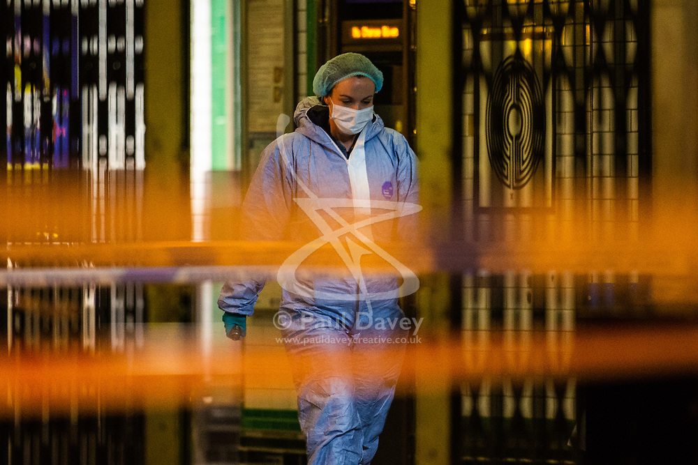 A forensics investigator is sen inside the tube station at the scene where a seventeen-year-old , the second teenager in less than 24 hours, was stabbed and died outside Clapham South Underground Station. Clapham South, London, November 02 2018.