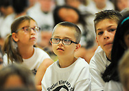 Rocco Grabov, a second grade student, listens to the speakers onstage during the 50th Anniversary celebration at Simon Butler Elementary Elementary School Friday June 12, 2015 in Chalfont, Pennsylvania.  (Photo by William Thomas Cain/Cain Images)