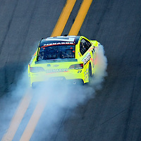 NASCAR Sprint Cup driver Paul Menard (27) catches fire during the NASCAR Coke Zero 400 Sprint series auto race at the Daytona International Speedway on Saturday, July 6, 2013 in Daytona Beach, Florida.  (AP Photo/Alex Menendez)