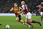 Aston Villa defender Alan Hutton (21) and Hull City forward Jarrod Bowen (20) battles for possession  during the EFL Sky Bet Championship match between Hull City and Aston Villa at the KCOM Stadium, Kingston upon Hull, England on 31 March 2018. Picture by Mick Atkins.