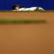 Seattle Mariners Ichiro Suzuki stretches before game 3 of the ALCS in New York Yankees stadium.