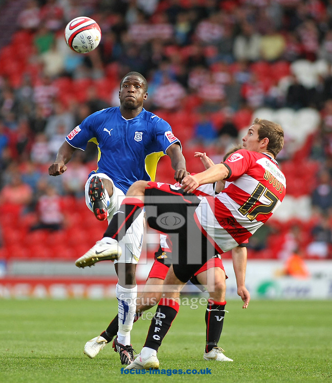 Doncaster - Saturday 29th August, 2009:Martin Woods of Doncaster Rovers & Soloman Taiwo of Cardiff City battle for the ball during the Coca Cola Championship match between Doncaster Rovers & Cardiff City at The Keepmoat Stadium Doncaster. (Pic by Steven Price/Focus Images)