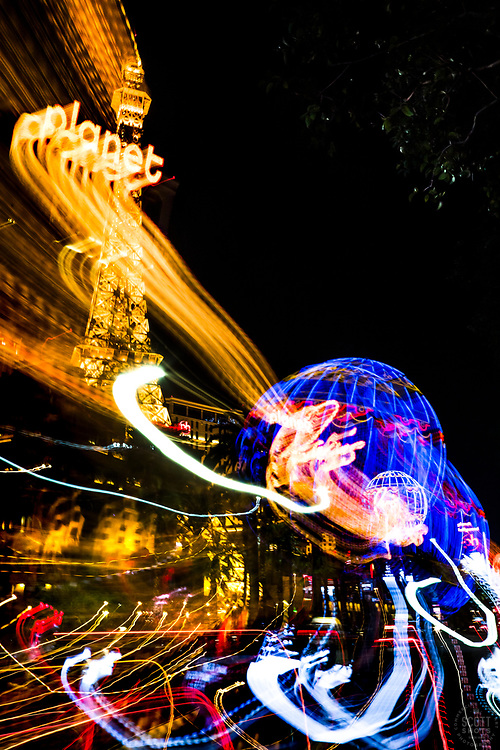 """""""Las Vegas Lights 11"""" - Photograph taken at the Las Vegas, Nevada Strip at night. The look was achieved by shooting a handheld long exposure and zooming the lens during the exposure."""