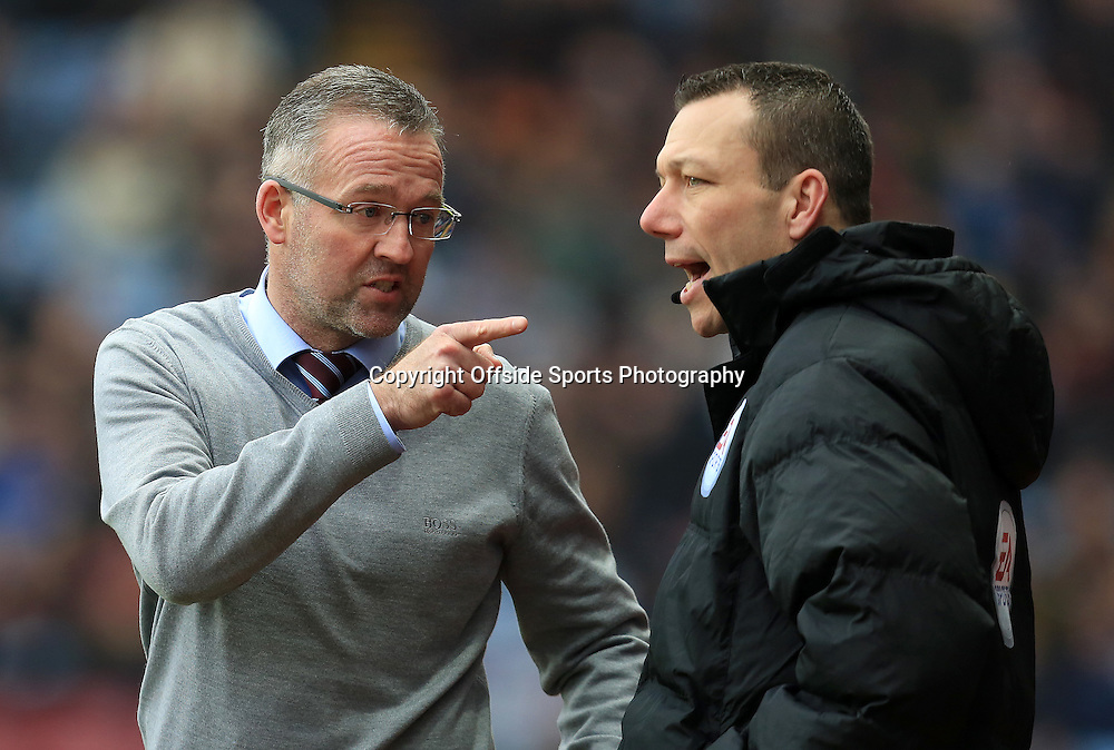7th February 2015 - Barclays Premier League - Aston Villa v Chelsea - Aston Villa manager Paul Lambert points an accusing finger at 4th official Kevin Friend - Photo: Paul Roberts / Offside.
