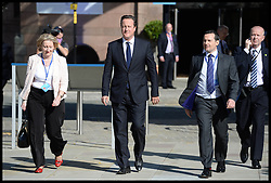 The Prime Minister David Cameron walks over to the opening of the Conservative Party Conference at the Manchester Central, Manchester, United Kingdom. Sunday, 29th September 2013. Picture by Andrew Parsons / i-Images