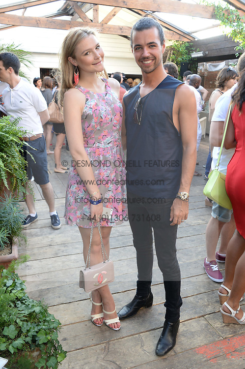 AMBER ATHERTON and PIERS HARGREAVES-ADAMS attending the Warner Bros. & Esquire Summer Party held at Shoreditch House, Ebor Street, London E1 on 18th July 2013.