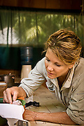 Karin Shetler, volunteering in a scarlet macaw research center in the Maya Biosphere Reserve in Guatemala.