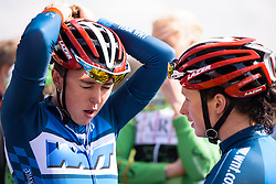 Hannah Walker pulling that ponytail a little too tight before sign in - Grand Prix de Dottignies 2016. A 117km road race starting and finishing in Dottignies, Belgium on April 4th 2016.