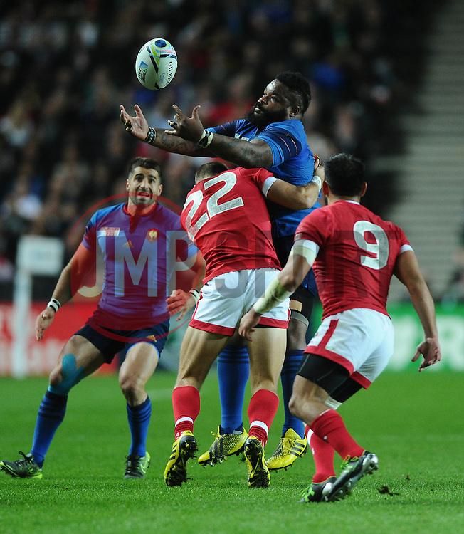 Harry Jones of Canada tackles Mathieu Bastareaud of France  - Mandatory byline: Joe Meredith/JMP - 07966386802 - 01/10/2015 - Rugby Union, World Cup - Stadium:MK -Milton Keynes,England - France v Canada - Rugby World Cup 2015