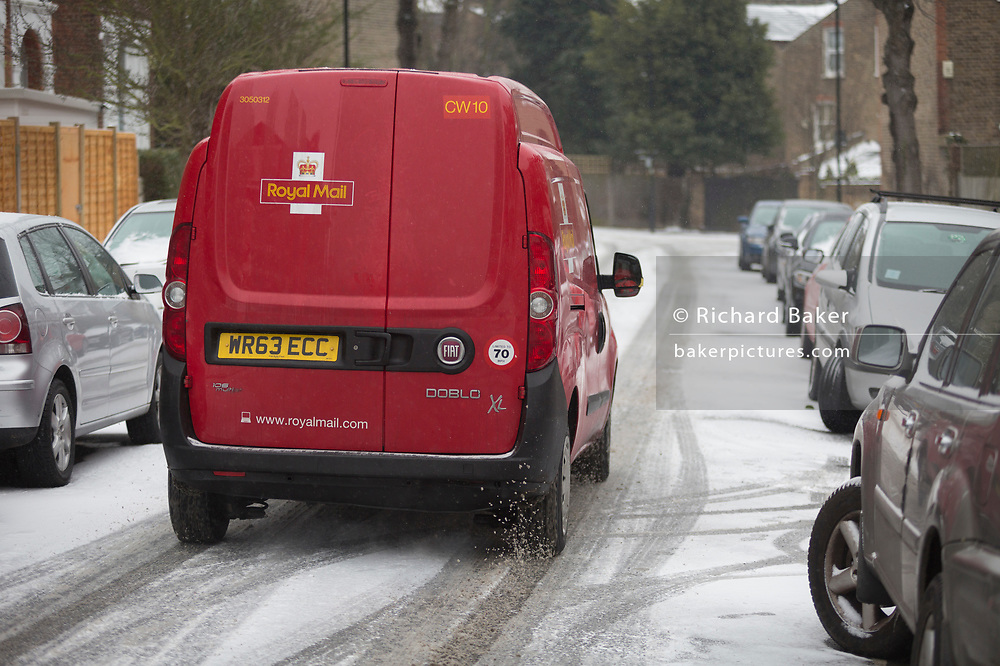 A Royal Mail van drives down a slippery residential road in south London during the bad weather covering every part of the UK and known as the 'Beast from the East' because Siberian winds and very low temperatures have blown across western Europe from Russia, on 1st March 2018, in Lambeth, London, England.