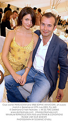 Club owner PIERS ADAM and MISS SOPHIE VANACORE, at a polo match in Berkshire on 27th July 2003.PLU 443