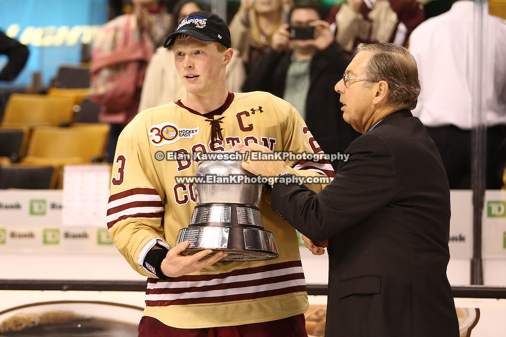Patrick Brown #23 of the Boston College Eagles is handed The Beanpot following The Beanpot Championship Game at TD Garden on February 10, 2014 in Boston, Massachusetts. (Photo by Elan Kawesch)
