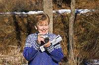 Lady with digital camera and brochure photo photography opportunity picture shutter bug hobby bobbies