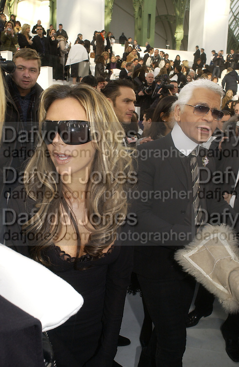 Victoria Beckham and Karl Largerfeld. Chanel couture fashion show. Grand Palais, Ave Winston Churchill. Paris. 24  January  2006.  ONE TIME USE ONLY - DO NOT ARCHIVE  © Copyright Photograph by Dafydd Jones 66 Stockwell Park Rd. London SW9 0DA Tel 020 7733 0108 www.dafjones.com