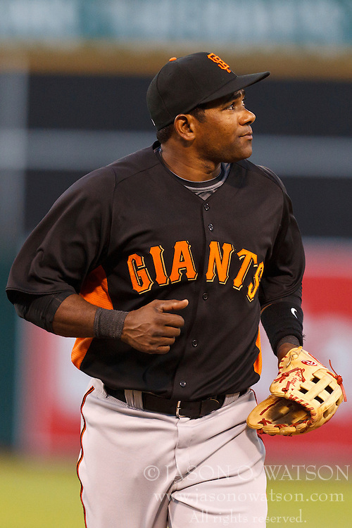 March 29, 2011; Oakland, CA, USA;  San Francisco Giants shortstop Miguel Tejada (10) returns to the dugout during the first inning against the Oakland Athletics at Oakland-Alameda County Coliseum.  San Francisco defeated Oakland 4-1.