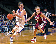 Kansas State forward Ashley Sweat (4) drives past Santa Clara guard Ashely Graham (22) in the second half at Bramlage Coliseum in Manhattan, Kansas, December 15, 2006.  K-State defeated Santa Clara 76-52.<br />