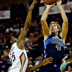 Dec 26, 2016; New Orleans, LA, USA;  Dallas Mavericks forward Dirk Nowitzki (41) shoots over New Orleans Pelicans guard E'Twaun Moore (55) during the first quarter of a game at the Smoothie King Center. Mandatory Credit: Derick E. Hingle-USA TODAY Sports
