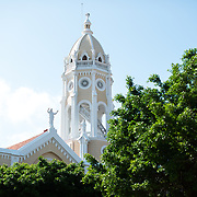 "The tower of Iglesia San Francisco de Asis as seen from Plaza Simon Bolivar. Surrounded by 19th century architecture, Plaza Simon Bolivar is a small public square in Casco Viejo, a block from the waterfront. It is named after Venezuelan general Simón Bolívar, the ""Liberator of Latin America"", and a statue of Bolivar stands prominently in the center of the square."