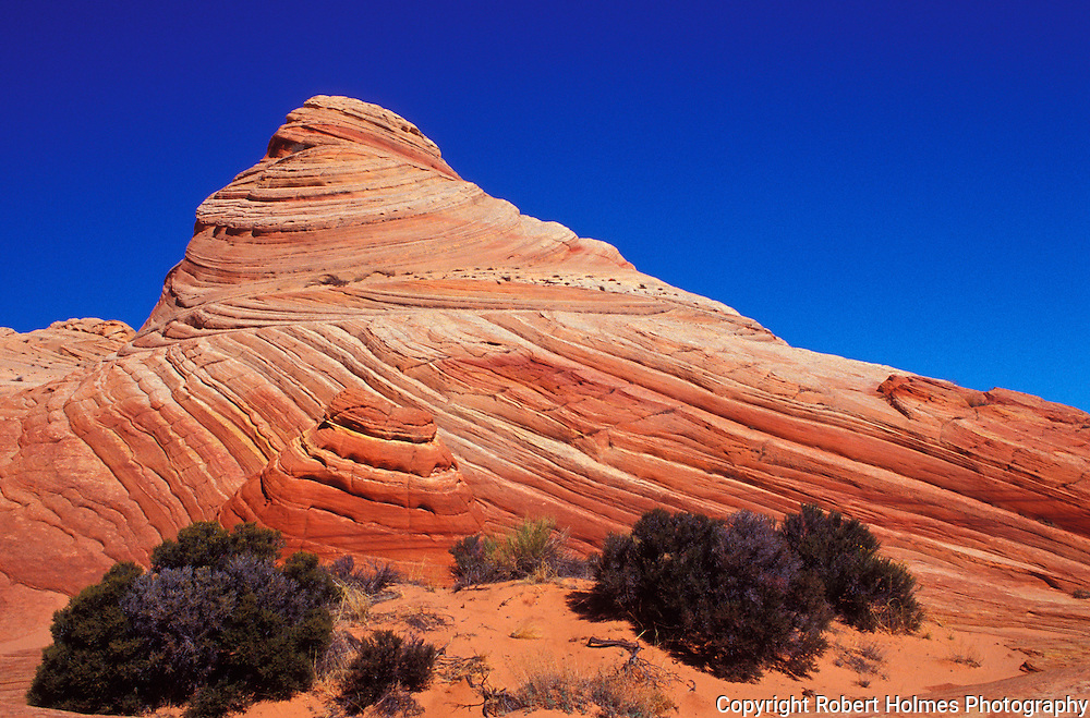 Arizona - This remote, unspoiled 294,000-acre national monument is a geologic treasure of towering cliffs, deep canyons, and spectacular sandstone formations, containing the Paria Plateau, Vermilion Cliffs, Coyote Buttes and Paria Canyon.