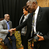 Adam Robison | BUY AT PHOTOS.DJOURNAL.COM<br /> Actor John Amos, the Guest of Honor, at the fourth annual Our Mississippi Honors Gala, shakes hands with Donald Cole, assistant provost with the University of Mississippi, as he and Eloise Mayfield, of Tupelo, talk during a meet and greet prior to the Gala at the BancorpSouth Conference Center in Tupelo Saturday night.