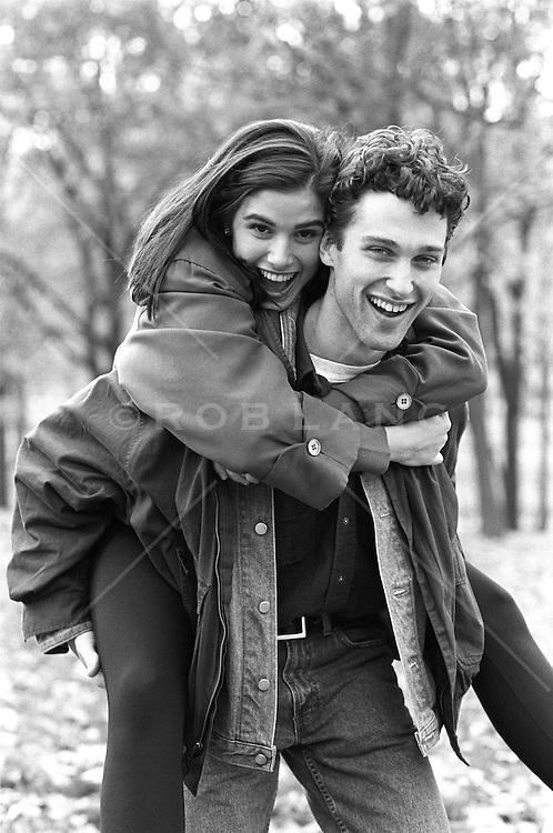 Man giving a girl a piggyback ride