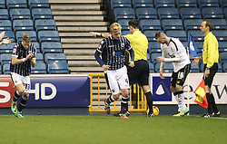 Referee Eddie Ilderton speaks to the linesman and changes his mind and awards a goal kick after protests by Millwall players- Photo mandatory by-line: Robin White/JMP - Tel: Mobile: 07966 386802 18/01/2014 - SPORT - FOOTBALL - The Den - Millwall - Millwall v Ipswich Town - Sky Bet Championship