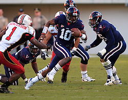 UVA QB Jameel Sewell rushes for part of his 92 yards against Maryland.  Despite Sewell's  first quarter rushing touchdown and two passing touchdowns, UVA fell to the Terps, 28-26 at home on October 14, 2006.