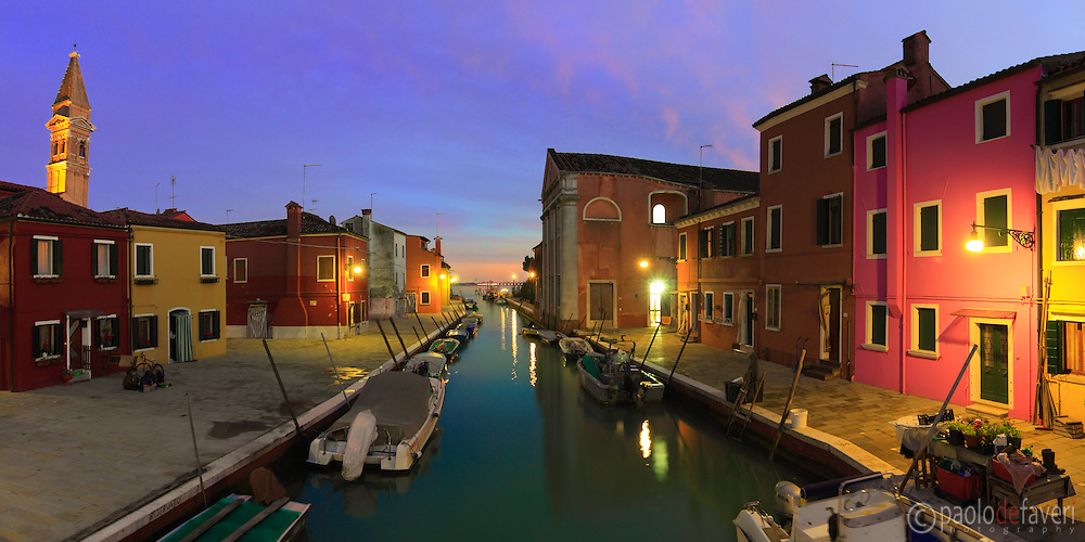 Taken about 30 minuts after sunset from a bridge in Burano, Venice. This is a stitch of 6 verticals. On the left, the leaning bell tower of the church of San Martino.