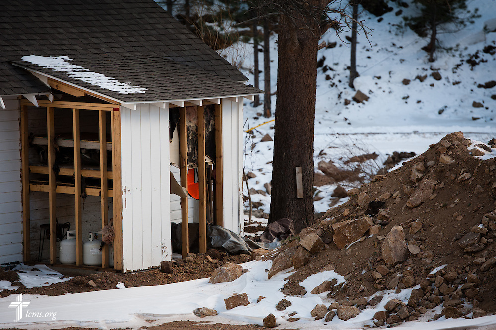 An exterior photograph detailing remaining flood damage at Whispering Pines Cottages on the River, which was extensively damaged in the September floods, on Tuesday, Jan. 7, 2014, in Estes Park, Colo. LCMS Communications/Erik M. Lunsford